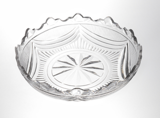 Shallow circular bowl; encircled star cut on bottom, narrow flutes rise to swags filled in with fine flutes. Trefoil cut rim. Well defined cuts.
