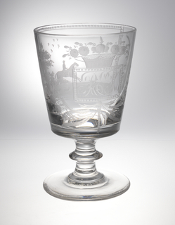 "Bucket bowl, outward sloping, stem with bladed knop rising from flat circular foot with pontil depression. The bowl wheel engraved with initials ""R E K"" in rectangular frame centered on wreath of flowers and grain sprays; on other side: within a frame, a mounted horseman riding left in silhouette with hounds in panel below and birds in flight above. Leafy tree to right at panel's edge."