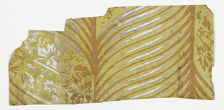 Irregular. Portion showing parallel bands set with long ogee stripes, alternating orange and white, periodically interspersed with bands of grapeleaves and tendrils. Printed in orange and white on yellow ground.