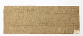 Plain tan oatmeal paper in rough embossed pattern. Simulating crepe or moire.