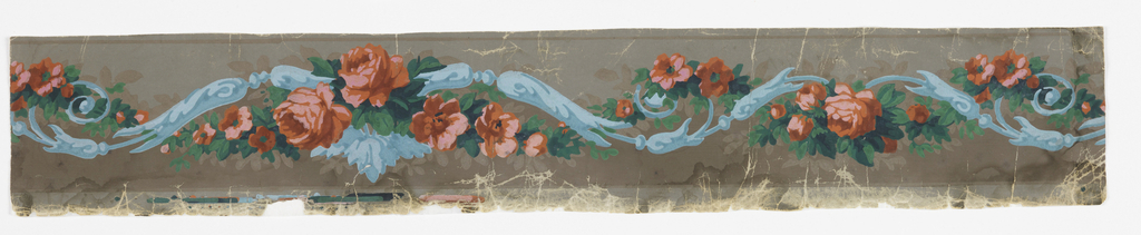 Undulating blue scrollwork entwined with a rope of orange-pink roses and green leaves. Printed on dark gray ground.