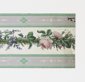 On glossy white ground, continuous band of entwined pink roses, small lavender flowers, green foliage, between edge bands of green lines and triangles and white geometric patterns, dots.