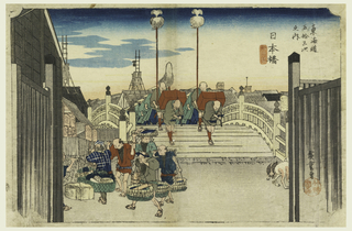 Hirogshige: plate 1. Morning view (Nihon-bashi, asa-no-kei) subtitle of second state: gyōretsu furude (processional Standard-bearers).  This print shows the middle class during the late Edo period. Located on the bridge over the Kamo River, in the early morning, is a seen of daimyo's procession crossing bridge, two porters carrying red boxes followed by two standard-bearers. Just past the bent over figures are rows of samurai marching in unison and then a dark silhouette of the city roofs and shops, and stores. In the forefront are six street hawkers, all carrying loads of heavy merchandise. Caught in the middle is a fishmonger balancing a shallow tray of fish on his head. A man on the left can barely be seen hidden behind the gate. Facing us is a man wearing a brown kimono. Next to him on the left is another man, wearing a checkered kimono and indigo spotted headcloth (okosozukin), caring huge bundles of furoshiki. Amongst the bustling morning is a pair of dogs in the lower right-hand corner.