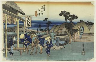 "Here is a spritely scene of travelers outside a teahouse of the town of Totsuka. From Edo (Tokyo) to Totsuka at the time, was about one day's journey. There is a man gingerly mounting off his horse. On the left of him, a female maidservant, finely dressed is greeting the visitors after their long voyage. There is a man on the right, standing next to the horse, is a porter, with his back facing us. Next to him is a woman who is carrying a large bundle, still balanced on her back. On the right side is an elderly man, nimbly balancing many bundles on his body while crossing the bridge.  A milestone next to the bridge says, ""For Kamakura, Turn Left."" The animated indigo streaks on the foreground indicate that nightfall is swiftly approaching."