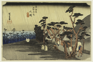 "This rainy scene shows travelers entering the village of Oiso. The town is surrounded by pine trees which also decorate the water's edge. ""Tora-ga-ame"" translates to ""Tiger Rain"" or ""Tears of Tora."" The legend of Tora tells about a heroine of the famous Soga Story. She lived in the town of Oiso and turned into stone by her grief."