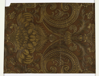Bisymmetrical leaf and plant forms embossed in gold on glazed brown ground.