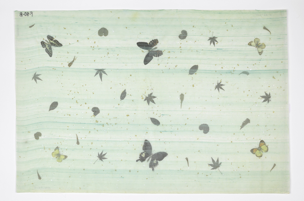 Butterflies (with printed paper bodies), leaves and specks of gold and silver laminated between rice paper and turquoise silk gauze. Marked in inkL P-80-B.