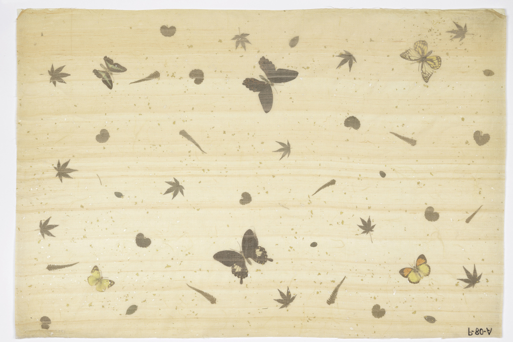 Butterflies (with printed paper bodies), leaves and specks of gold and silver laminated between rice paper and pale pink silk. Marked in ink: P-80-A.