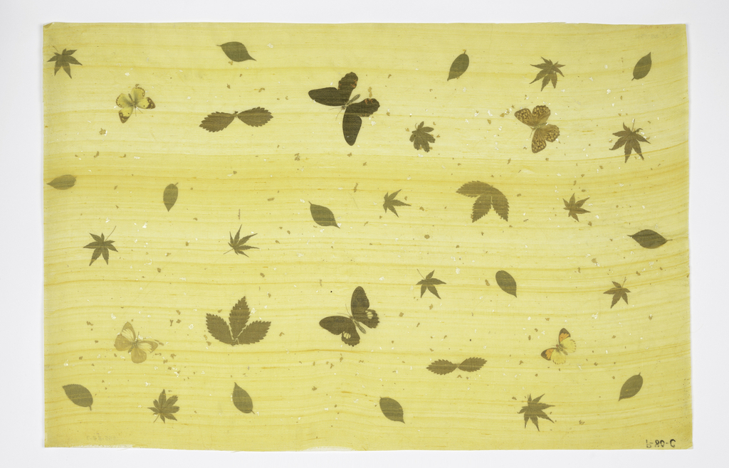 Butterflies (with printed paper bodies), leaves and specks of gold and silver laminated between rice paper and with lemon silk. Marked in ink: P-80-C.