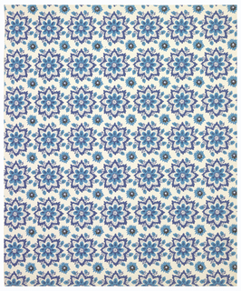all-over pattern of medium size flowers alternating with small flowers. Very stylized. Printed in two shades of blue and black on a white ground