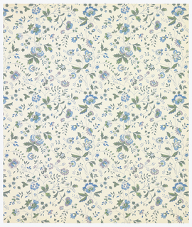 very delicate pattern inspired by Indian chintz design. All-over vining floral design. Printed in two shades of green, blue and lavendar on white ground