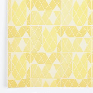 """Three samples removed from """"American Futures III, Volume 19"""" sample book. a) Cockle Shells - randomly arranged shells having the appearance of being photographically reproduced. Each shell has gold highlights. Printed on a tan background simulating sand; b) Diamond Mosaic - grid pattern composed of tiny diamond motifs. Printed in three shades of yellow on white ground; c) Courtyard Texture - grid pattern forming vertical rows, alternating between narrow and wide. Composed of small rectangular boxes, each containing different textural elements. Printed in brown using blue print process."""
