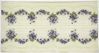 Borders printed two across the width (mirrored). Floral swag with purple flowers, underneath which are a scalloped treillage pattern and green panel with moiret, divided by waving lines. Ground is white. Printed in purples, greens, white mica. 