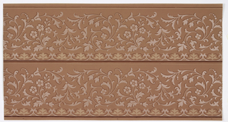 Borders printed two across the width. Waving floral scrolls with foliate scrolling and foliate motif underneath. Ground is pink. Printed in light pink mica, cream, and dark pink.