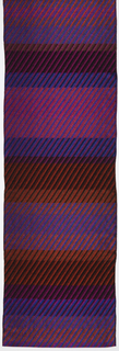 Horizontal (weft) stripes in blues, pinks, and reds. Additional woven diagonal stripes in black and the same blues, pinks, and reds. Metallic throughout.