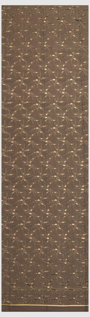Woven in browns, ivory, and metallic bronze with leaves superimposed on a moiré or wood grain effect.