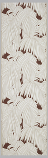 Large all-over white palm leaves on a maroon background with metallic silver on a tan ground.
