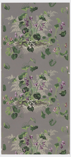 Purple, pink, and white violets with green leaves and beige fern leaves in a cluster on a grey ground.