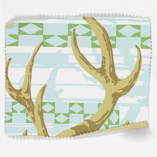 Tops of antlers. Printed in tan, turquise and green on white ground. This sample is pinked around the edges.