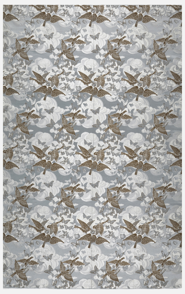 Light blue ground with birds and butterflies in brown and pale blue clouds.