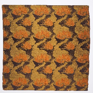Length of woven fabric with a brown ground and a bold pattern of orange flames and swirling gold clouds of rising smoke forming paisley-like forms; salamanders move among the flames. Le Feu is one of a series of silks representing the four elements (earth, air, fire and water) exhibited at the Exposition Internationale des Arts Decoratifs, Paris, 1925.