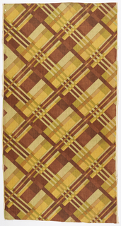 Length of printed linen with a diagonal plaid in two browns, green and yellow. Illusion of a second green is made by overlapping colors.