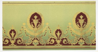 Art Nouveau/Mission Style. Alternating small and large wreaths, with vase-like motif insets. Connected by ribbons with torches, floral swags, and folliate scrolls. Top has ribbon and beaded swags. Bottom has stripes and bead-and-spindle pattern. Ground fades from green (bottom) to light green-yellow (top). Background is a layer of dark green vermiculation. Printed in dark red, metallic pink, and two shades of metallic gold.  Printed in selvedge: C & W (?) 0.257