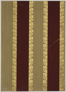 Vertical stripes, 5 1/2 and 3 1/2 inches wide alternating. The wide stripe is bordered on each side by a floral design. Its center is filled with a vertical textural weave-simulation. The 2 1/4 inch stripe is vertically designed with fine line lace pattern. Printed in burgundy, green ocher, ecru and gold mica.