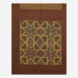 Silk curtain panel in dark blue, white, green and yellow silk on a dull red ground. The yellow silk forms the major part of the design: ten panels of exquisitely drawn arabesques are formed entirely of yellow silk wefts; the composition of the two tile panels is also largely outlined by the yellow. In the upper star panel, the pattern is formed by means of a system of super-imposed large and small squares. The outlining bands of the squares have been merged into a complicated system of interlacing strap work. In the ornament of the upper border the arabesque arches are actually supported on columns. Elaborate interlaced patterns fill the narrow bands at top and bottom.