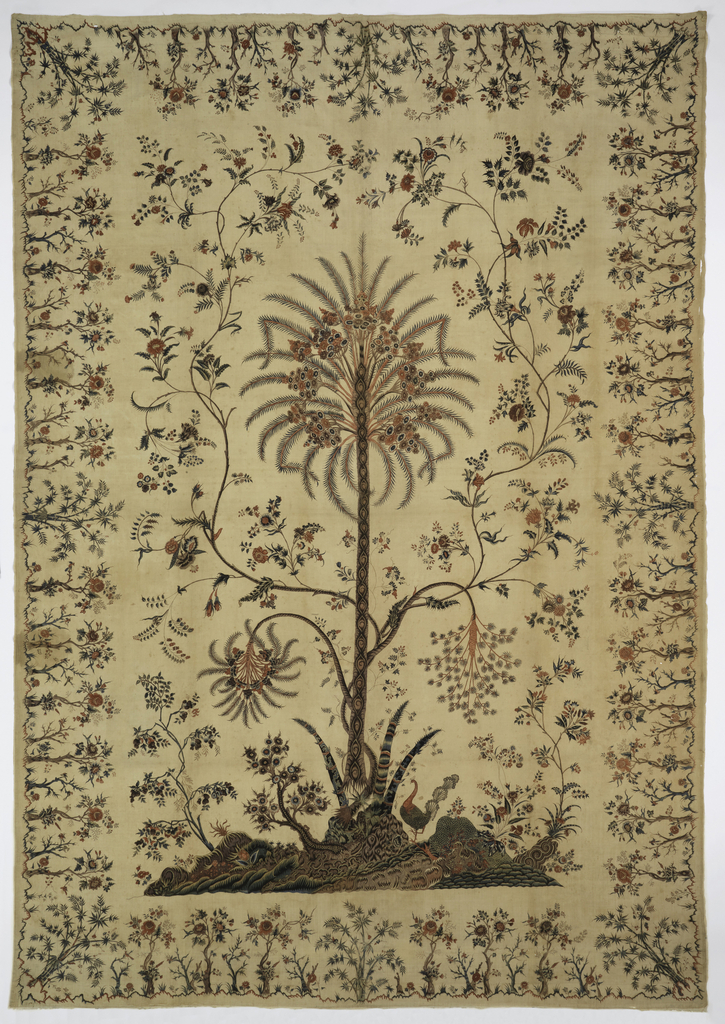 A palampore or tent hanging with a center field and border. The field is dominated by a tall, straight, slender palm (possibly date?) rising from a mound, with a full crown of feathery foliage and fruit clusters. From lower on the trunk spring, at one side, a small palm head, bending gracefully, and from the other side a down-curving branch of blossoms. From the mound grows a slender flowering vine, which divides and winds upward, forming a frame for the tree's head. Small flowering trees grow from either corner of the mound; to the left of the palm is a short rugged tree, bamboo shoots grow close to the trunk of the palm, and to the right stands a handsome peacock. The trunk of the palm is marked with an eliptical pattern, and its roots are exposed.   The border, 15 inches wide, is a repeating pattern of short trees, and in each corner, a small bamboo tree. The rows of little trees grow from a curving ground line, suggesting mounds.  In two reds, blue, green, red-violet, yellow (now much faded) and red-brown outlines on an off-white ground, without seam. Lined with cotton.