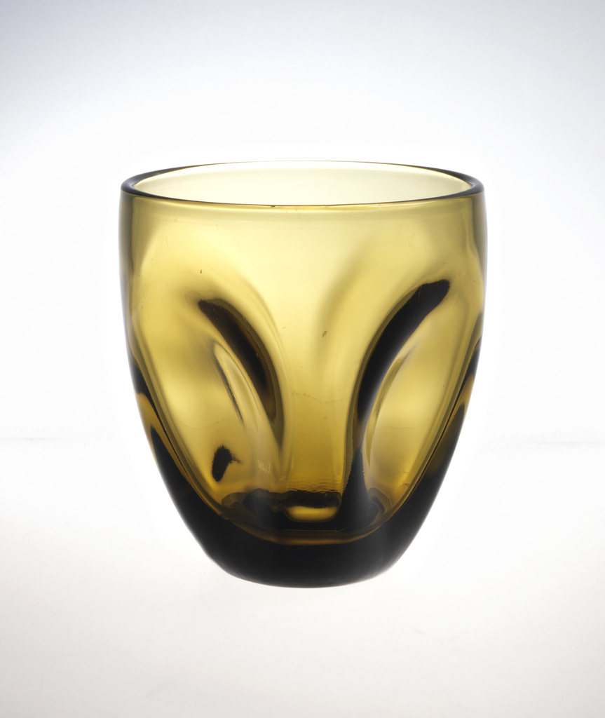 Transparent olive green glass with vertical impressions.