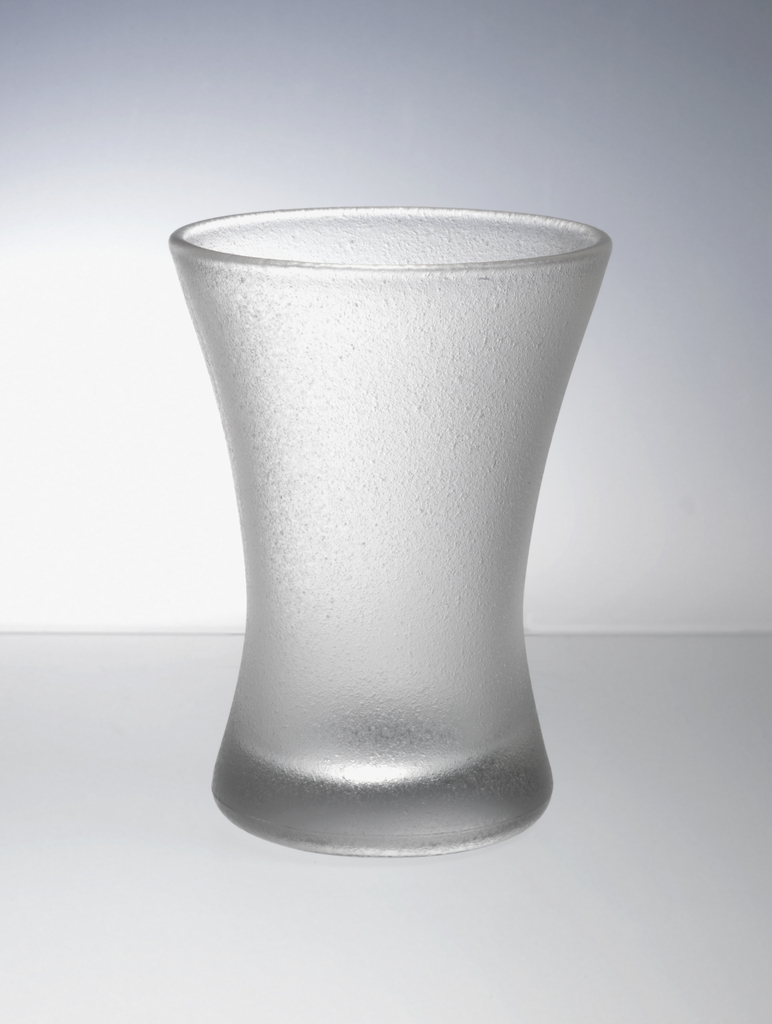 Frosted clear glass cinched at center with flared mouth.