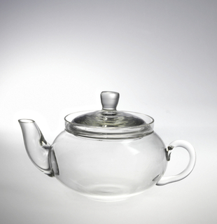 Small teapot shape. Squat, globular body; stout curving spout; loop handle oriented horizontally on opposite side of body; domed lid with flaring finial.