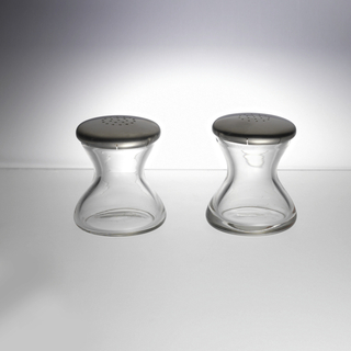 Flat-bottomed clear glass containers of hourglass profile, each fitted with circular slightly domed brushed stainless steel cover. Covers slotted in eight places under edge to secure to glass lip; each cover pierced.
