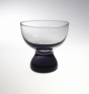 Smokey gray black glass with wide mouth and solid foot in bell shape.