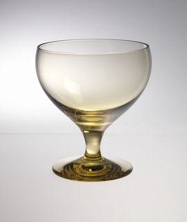 Transparent green yellow glass with wide mouth and solid footed stem.