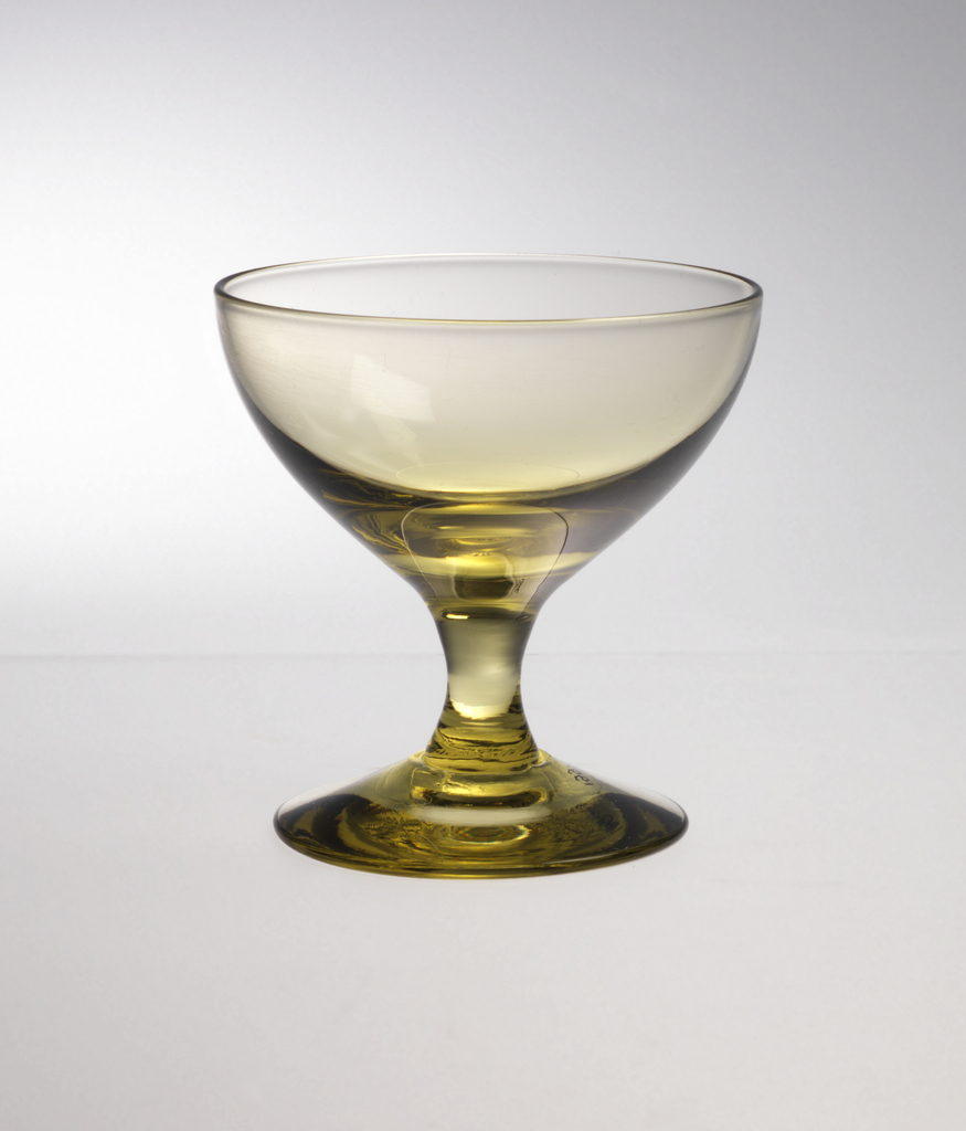 Chartreuse glass with wide mouth and solid footed stem.