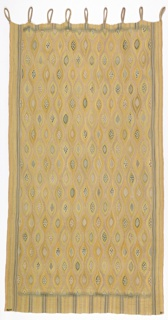 Hanging of wool in tapestry weave, in yellow, white, grey, and green. Pattern shows allover oval shapes; piece signed.