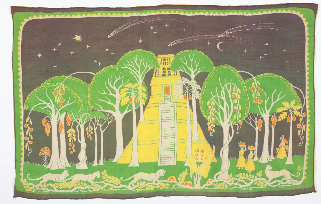 Horizontal rectangular hanging with a landscape dominated by a pyramid-shaped yellow temple with a long flight of white steps leading to an orange door. The temple is surrounded by trees with white trunks and green foliage, with exotic fruits hanging down. Three female figures approach from the right with baskets of fruit on their heads.  A dark grey sky has stars, planets, sun and moon in white. Jaguars prowl the foreground among crawling vines.