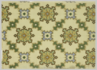 On honeycomb light peach ground, treillage of medallions in blue, cream, brown, green, and tan.