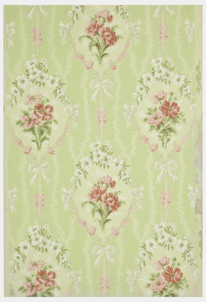 Floral bouquet in medallion, printed in void of moire-like background. Printed in green, pink and white.