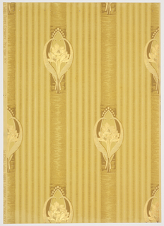 Art nouveau; three small tulips on long stems enclosed in large curved tulip leaves. The motif is set into a vertical stripe, two inches wide in 4 1/2 inch repeat. 5 1/4 inch stripes fill the space between the large stripes. Printed in ocher, off-white and gold mica on a pale gold background.