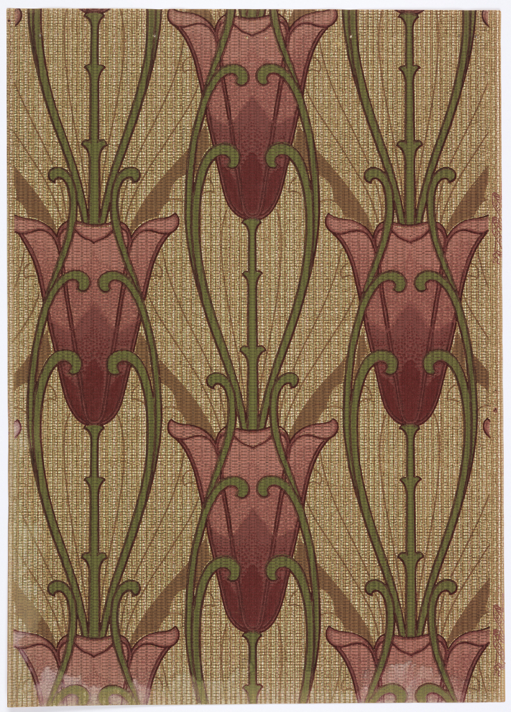 Art nouveau; oversized tulips, vertical direction, on long stem and fine line oblong scrolls in the background. A dense texture simulating a weave cover the background. Printed in shades of red, green, brown and tan.