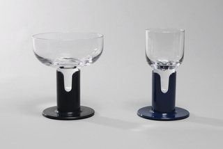 Clear glass cylindrical goblet inserted into blue plastic stem.