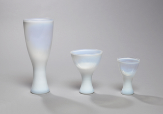 Tall, of opalescent glass, with slightly flared foot.