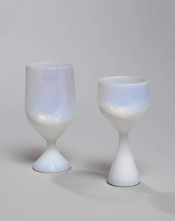 Opalescent glass; bell-shaped with foot.