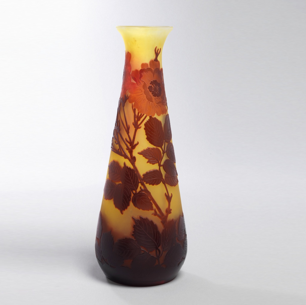 Tall vase with wide base and flared mouth; red amber flowers on yellow background.