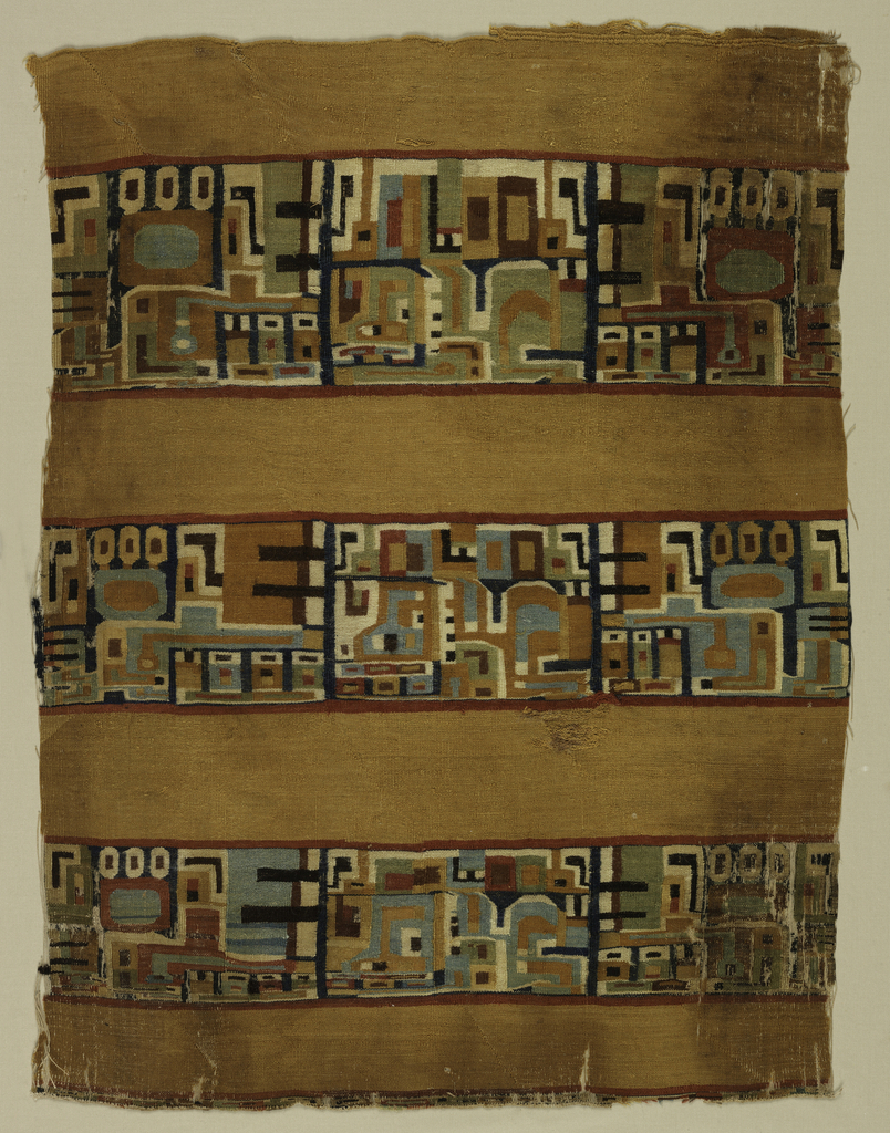 Fragment of a Peruvian tapestry-woven mantle with a rich ochre ground and three wide bands with highly stylized animal motifs in shades of blue, green, tan, white, black, and red, set off by narrow red guard stripes.