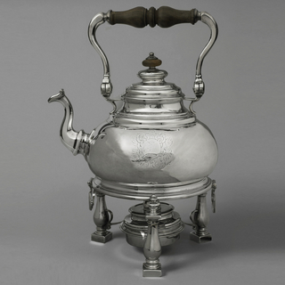 (a) Bulbous body with molded neck, paneled covered spout and pivoting-shaped handle with turned wood centerpiece. Side engraved with scrolled arms. (b) Molded cover with wood knob; (c) stand on three baluster legs on square plinth with large ring for kettle, smaller for lamp; (d) cylindrical lamp with (e), cover with inner spout and hinged top to cover it.
