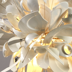 Hanging lamp composed of shards of broken white porcelain dishes, cups, saucers, serving pieces, and stainless steel cutlery, mounted on a metal frame work radiating from a central light source; the overall effect evoking an explosion of tableware.